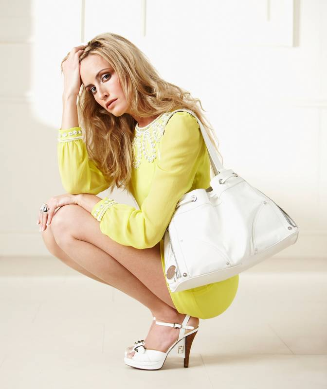 Blonde fashion model with white open toe stiletto and yellow vintage style dress and white tote