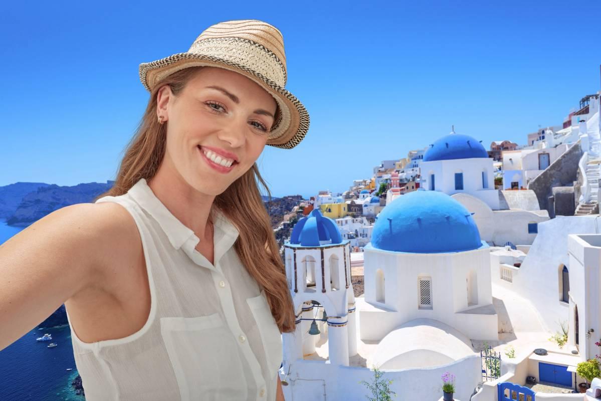 Santorini holiday selfie with blue sky and sunshine