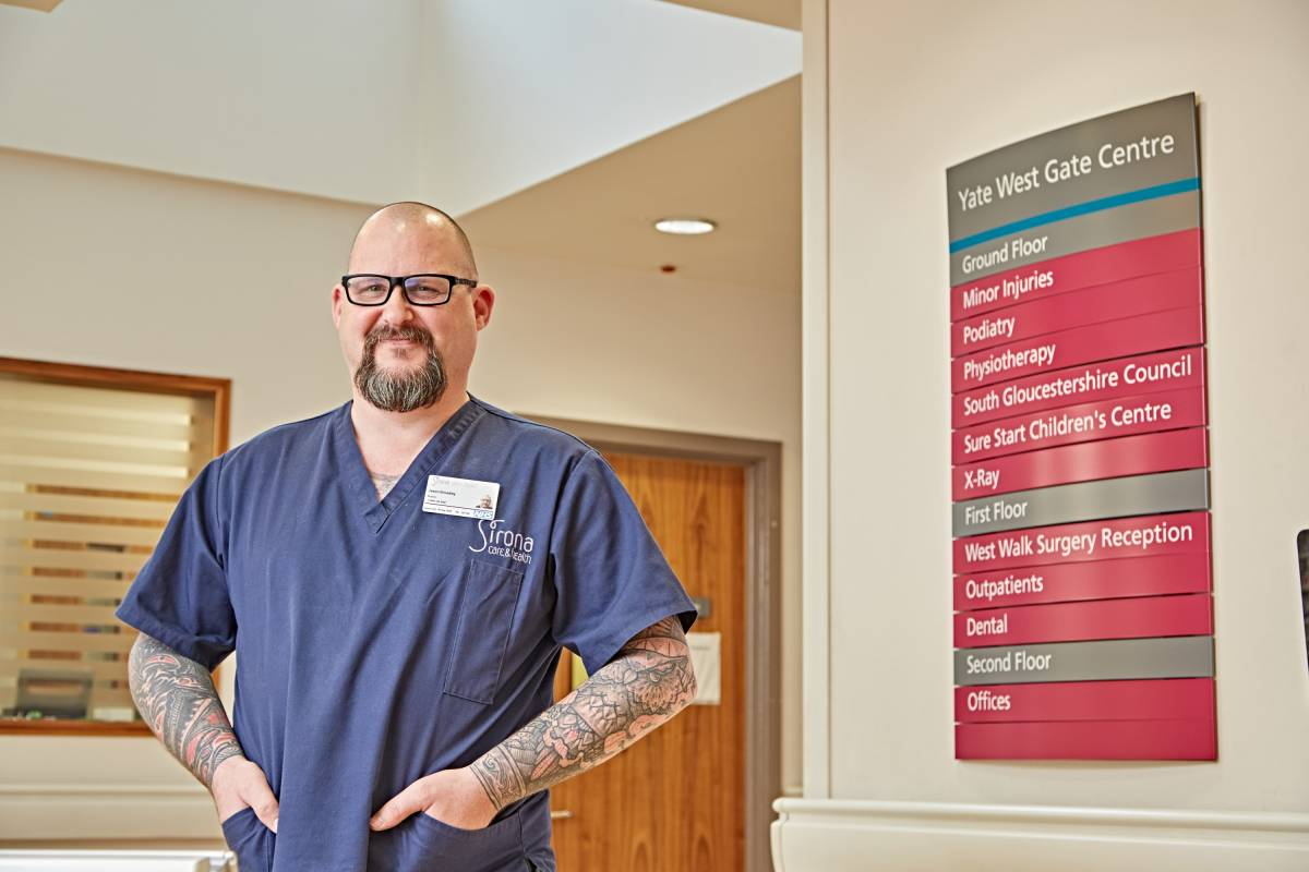 NHS worker with tattoos at hospital