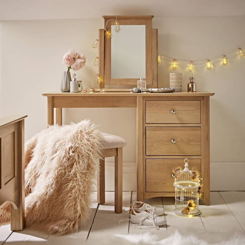 Oak dressing table with standing mirror and birdcage with fairy lights and fluffy throw