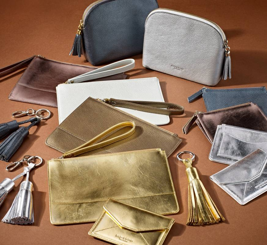 Byron & Brown leather purses and clutch bags with tassle keyring in gold, bronze, white and silver