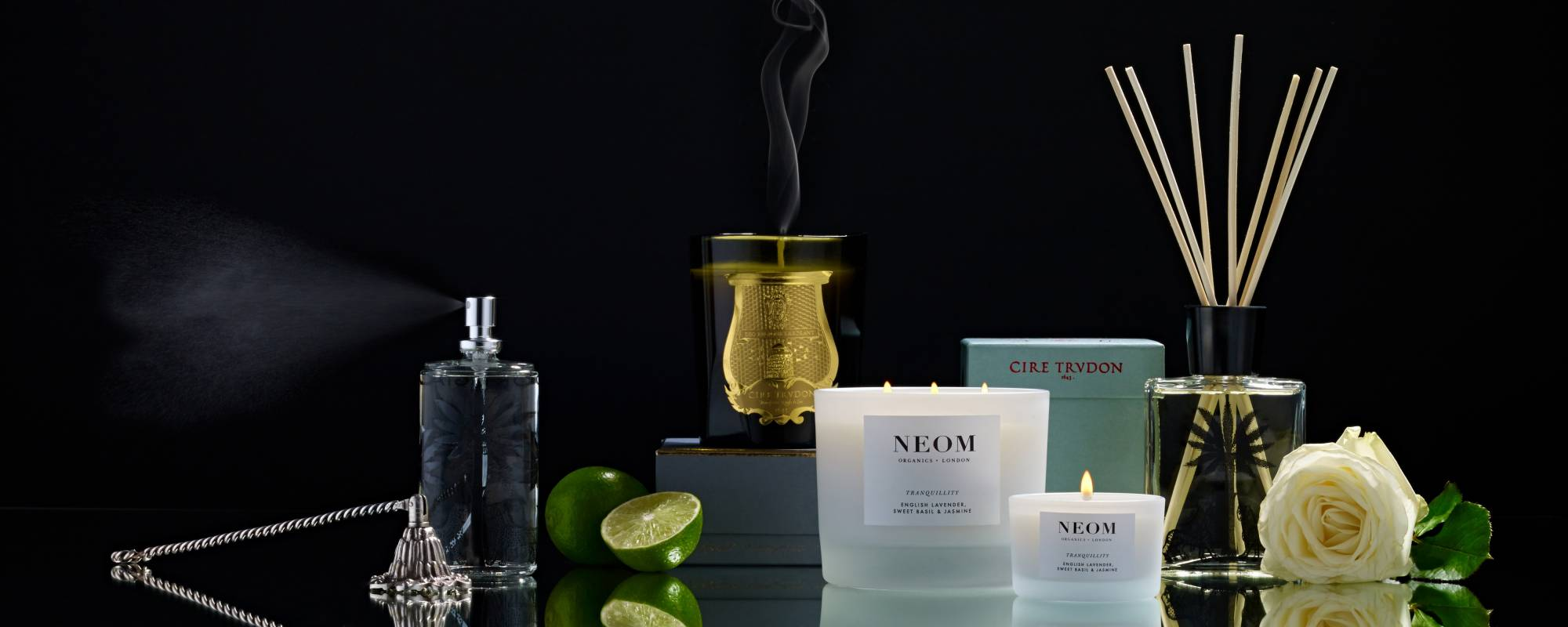 Neom and Cire Trudon candles with diffuser fragrance sticks